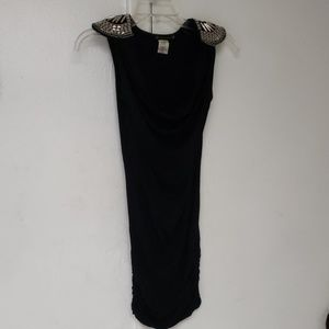 Black mini dress with shoulder pads